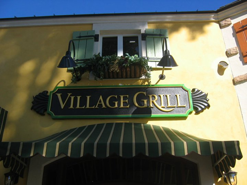Exquisitely designed exterior sign for Village Grill Restaurant