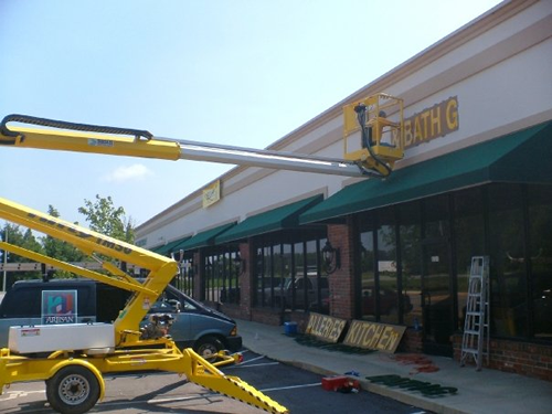 Using a crane for installation of building exterior signage